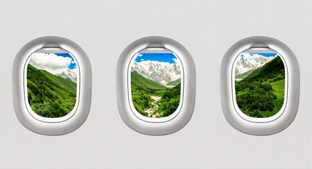 View of mountains in Georgia from airplane windows - flight concept