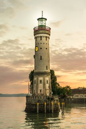 Lighthouse and sunset in harbor of Lindau in lake Constance, Germany