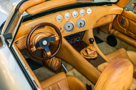 Steering wheel, shift lever and dashboard inside the luxury car