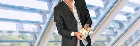 louver: Disheveled man in business suit with money in office