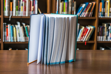 bookish: Standing book on the table in library Stock Photo