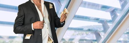 Disheveled businessman in a black suit and money in pockets in office