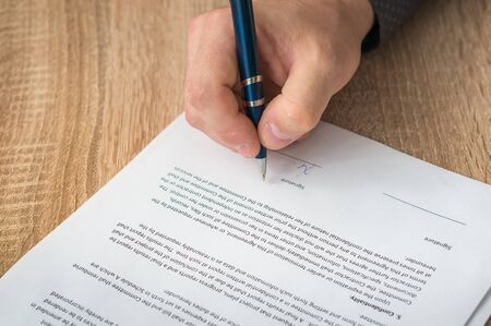 Businessman is signing a contract - business concept. Stock Photo