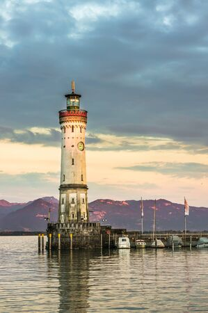 Beautiful evening seascape with lighthouse in harbor of Lindau in lake Constance, Germany Stock Photo