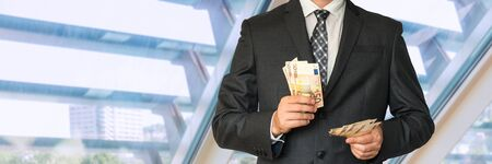 louver: Man in business suit with money in office Stock Photo