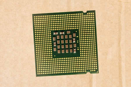 Computer processor chip (CPU) isolated on carton background. Stock Photo