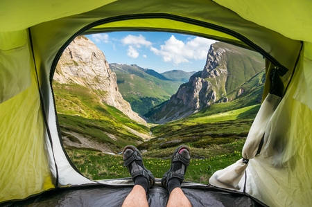 View from inside a tent on the beautiful grassy valley in the Macedonian mountains Stock Photo