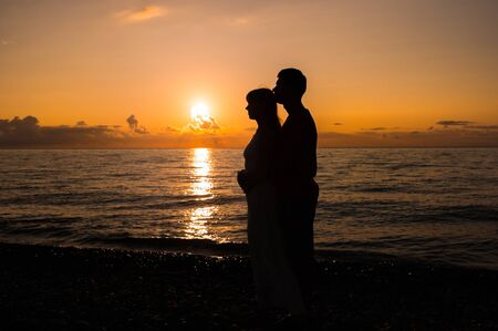 Romantic scene of love couples partners at sunset