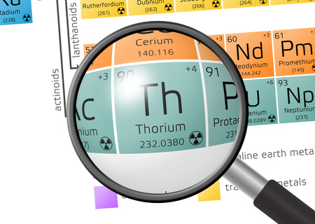 Thorium from Periodic Table of the Elements with magnifying glass Stock Photo