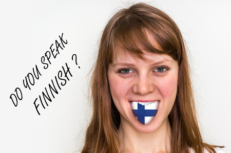 Do you speak Finnish? Woman with flag on the tongue - isolated on white background Stock Photo