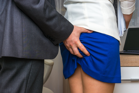 Man touching woman's butt - sexual harassment in business office Stock Photo - 74400161