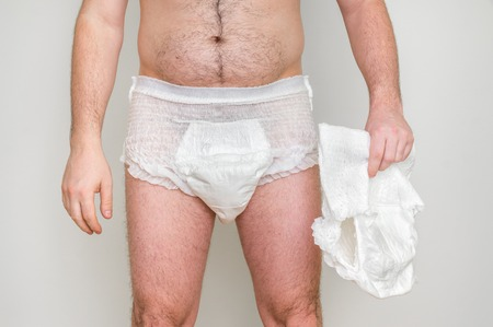 incontinence: Man wearing incontinence diaper isolated on white