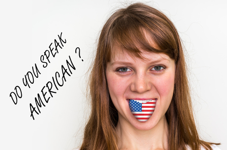 bilingual: Do you speak American? Woman with flag on the tongue - isolated on white background