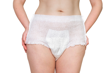 Woman wearing incontinence diaper isolated on white
