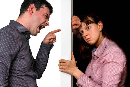 Unhappy couple arguing and do not understand each other, abstract wall between them and two sides of opinions - conflict and family concept