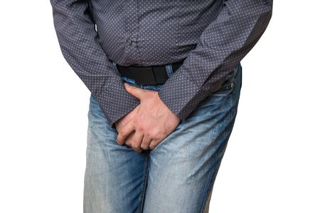 Mann mit Händen halten seinen Schritt, er will zu pissen isoliert auf weiß - Harninkontinenz Konzept Standard-Bild - 74521582