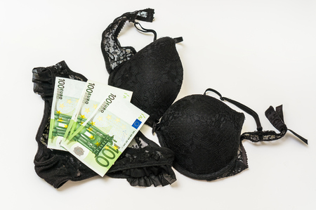 Womans panties and bra with euro money isolated on white background