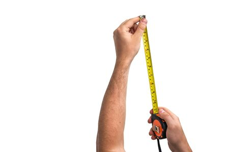 Tape measure in hand of worker isolated on white background Stock Photo