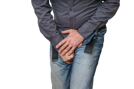 Man with hands holding his crotch, he wants to pee isolated on white - urinary incontinence concept