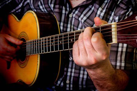 Man playing acoustic guitar. Close up guitar. Stock Photo