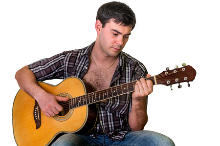 Young man playing acoustic guitar - isolated on white background