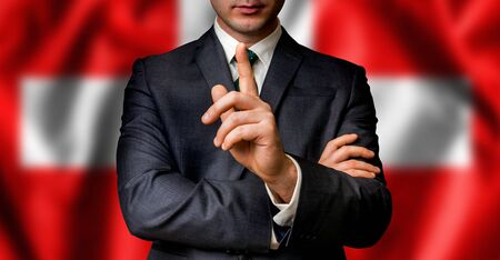 premier: Swiss candidate speaks to the people crowd with one finger on lips - election in Switzerland Stock Photo