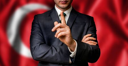Turkish candidate speaks to the people crowd with one finger on lips - election in Turkey