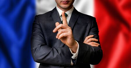 French candidate speaks to the people crowd with one finger on lips - election in France Stock Photo