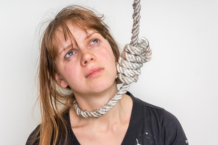 oneself: Depressed woman with a noose around her neck isolated on white - suicide concept