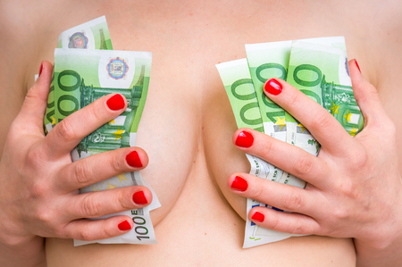 Attractive girl covered her sexy breast with euro money