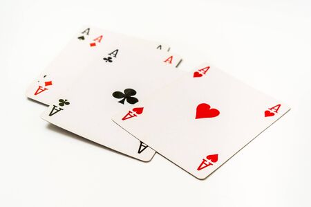 Four aces isolated on white background - casino gambling concept