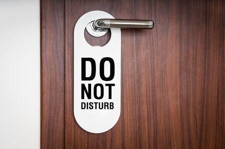 door knob: Door of hotel room with sign please do not disturb Stock Photo