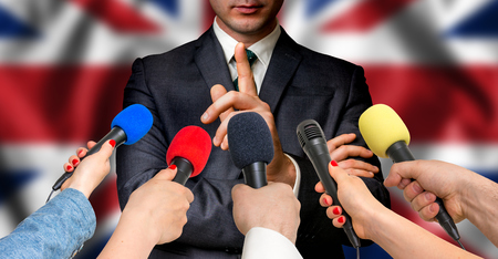 British candidate speaks to reporters. Election in United Kingdom (UK). Journalism and broadcasting concept.