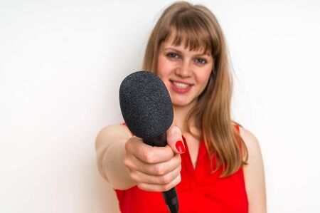 Journalist with black microphone making interview - journalism and broadcasting concept