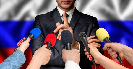 Russian candidate speaks to reporters. Election in Russian Federation (Russia). Journalism and broadcasting concept.