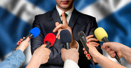 scottish parliament: Scottish candidate speaks to reporters. Election in Scotland. Journalism and broadcasting concept.