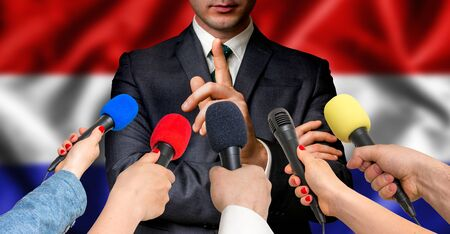 Dutch candidate speaks to reporters. Election in Netherlands. Journalism and broadcasting concept. Stock Photo