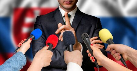 Slovakian candidate speaks to reporters. Election in Slovakia. Journalism and broadcasting concept.