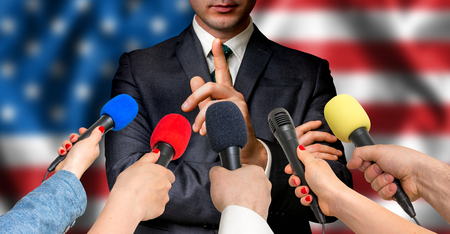 premier: American candidate speaks to reporters. Election in United States of America (USA). Journalism and broadcasting concept. Stock Photo