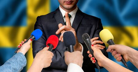 Swedish candidate speaks to reporters. Election in Sweden. Journalism and broadcasting concept. Stock Photo