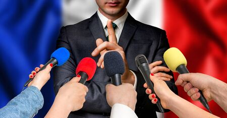 French candidate speaks to reporters. Election in France. Journalism and broadcasting concept. Stock Photo