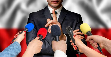 Polish candidate speaks to reporters. Election in Poland. Journalism and broadcasting concept. Stock Photo