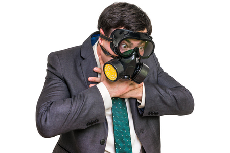 Businessman with gas mask can not breathe bad air - isolated on white