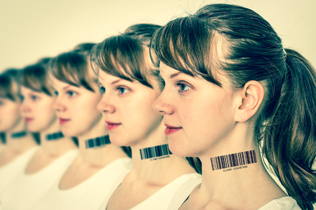 A lot of women in a row with barcode on neck - genetic clone concept - retro style Stock Photo