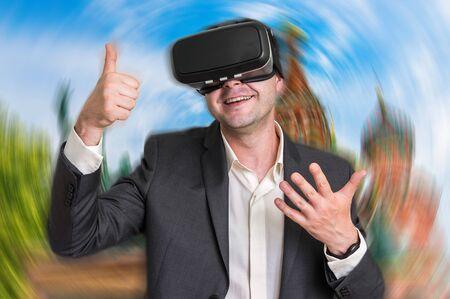 simulations: Happy businessman using virtual reality headset glasses