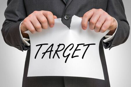 Businessman tearing paper with target word - business idea concept Stock Photo
