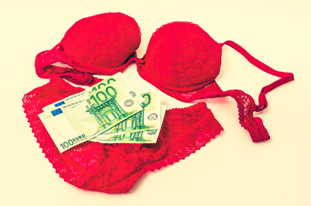 Red lacy underwear with money - retro style