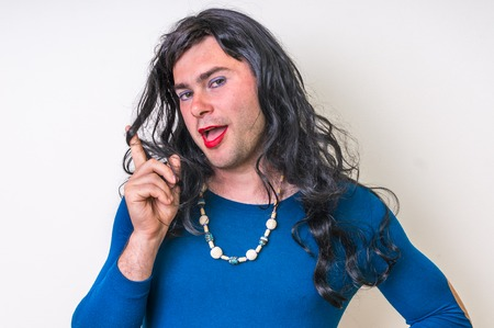 Bearded man wearing makeup and blue female dress