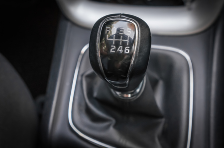 Vehicle interior with manual shift gear transmission stick - shift level concept