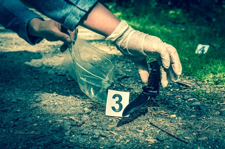 Investigator collects evidence (army knife) - crime scene investigation - retro style